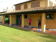 Pilates guests exercising outside Tuscan villa