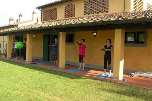 Pilates guests exercising outside Tuscan villa