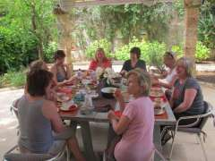 Women enjoying their breakfast outdoors after their Pilates lessons