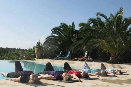 Pilates students relaxing by the pool after tailor-made class