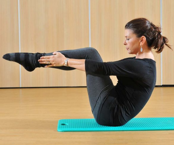 Diane Parrilla, the Pilates instructor in studio on mat exercising Pilates