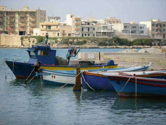 Idyllic harbour in Puglia with boats.