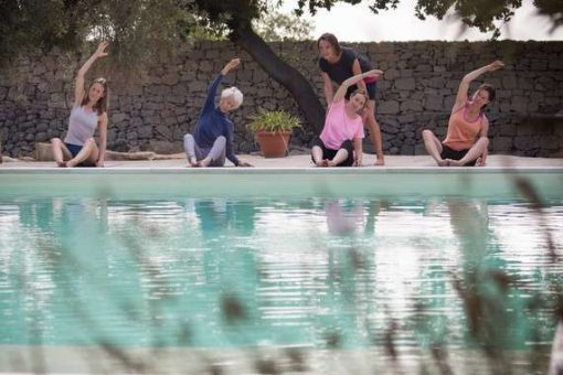 Pilates in Sicily by the pool.