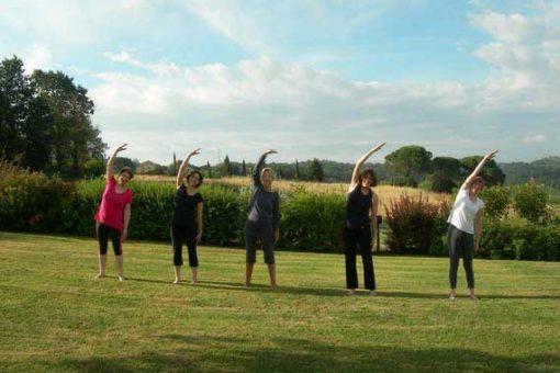 5 women doing Pilates in the Tuscan sun