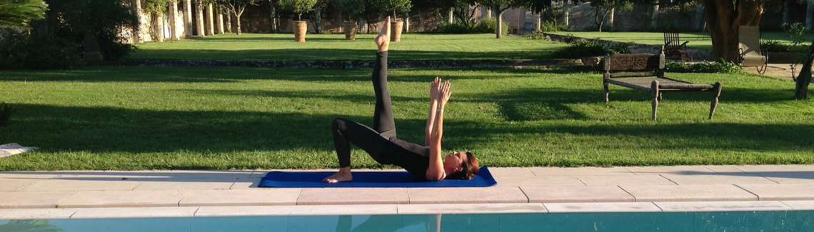 Experienced Pilates instructor doing Pilates exercise