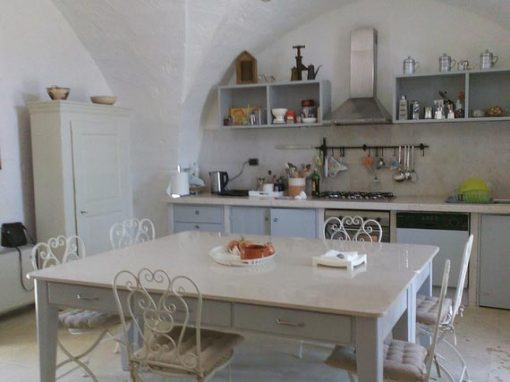 Rustic kitchen for cookery classes in historic holiday villa in Puglia.