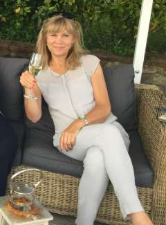 Rosalind Hoyes relaxing with a glass of Prosecco