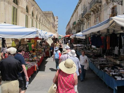 Guests visiting busy food market in Sicily.