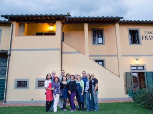Group of single travellers with Italian chef in front of venue
